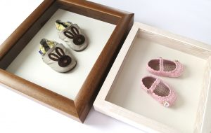 Framing objects baby shoes